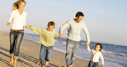 Family-running-on-the-beach